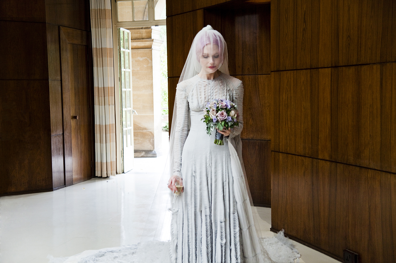 Pale grey slashed chiffon wedding dress designed by Gareth Pugh and veil by Stephen Jones 2011. Courtesy of Katie Shillingford. Photo Amy Gwatkin