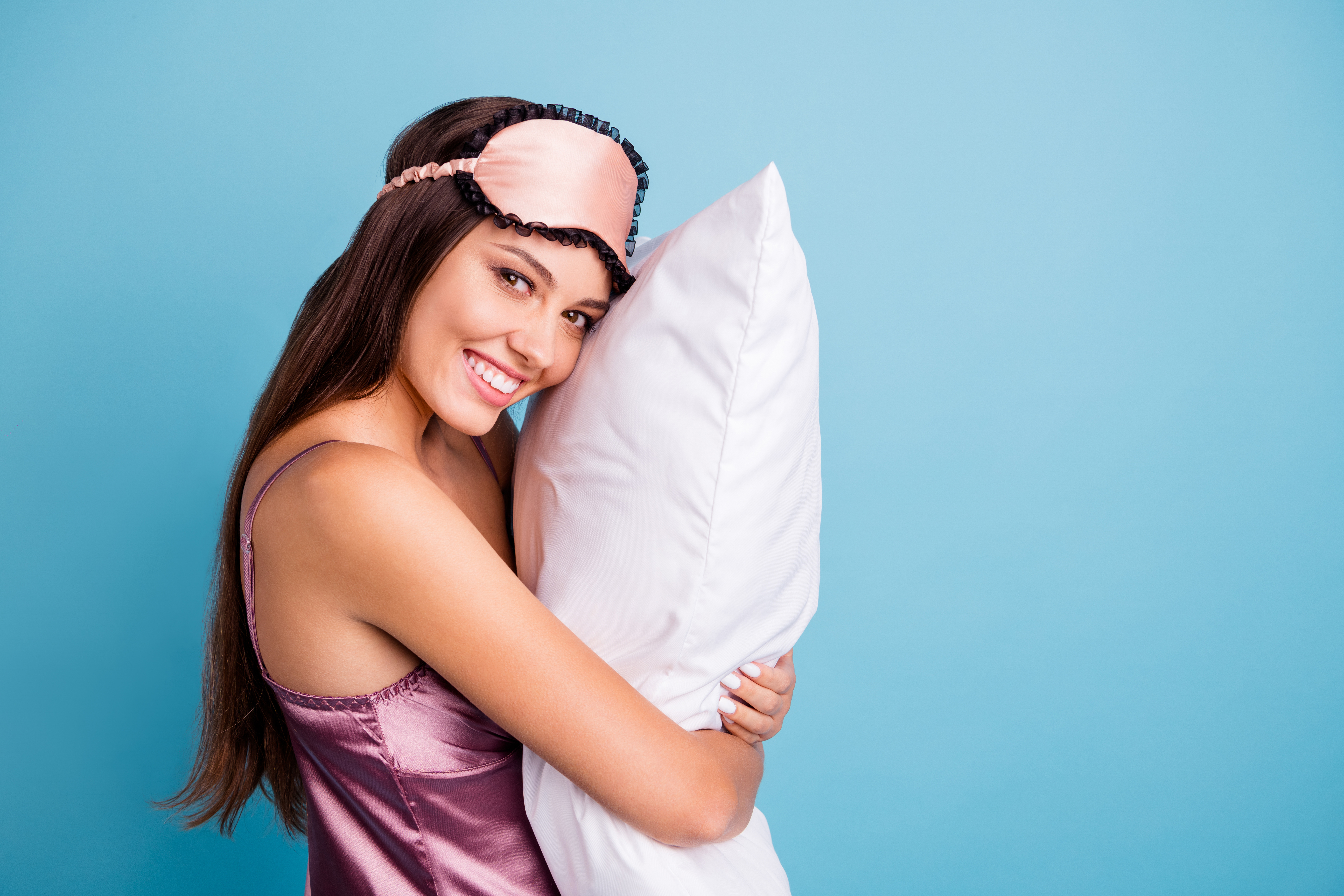 Profile side view portrait of her she nice-looking attractive lovely pretty feminine cheerful cheery girl embracing pillow late time isolated on bright vivid shine teal blue green turquoise background