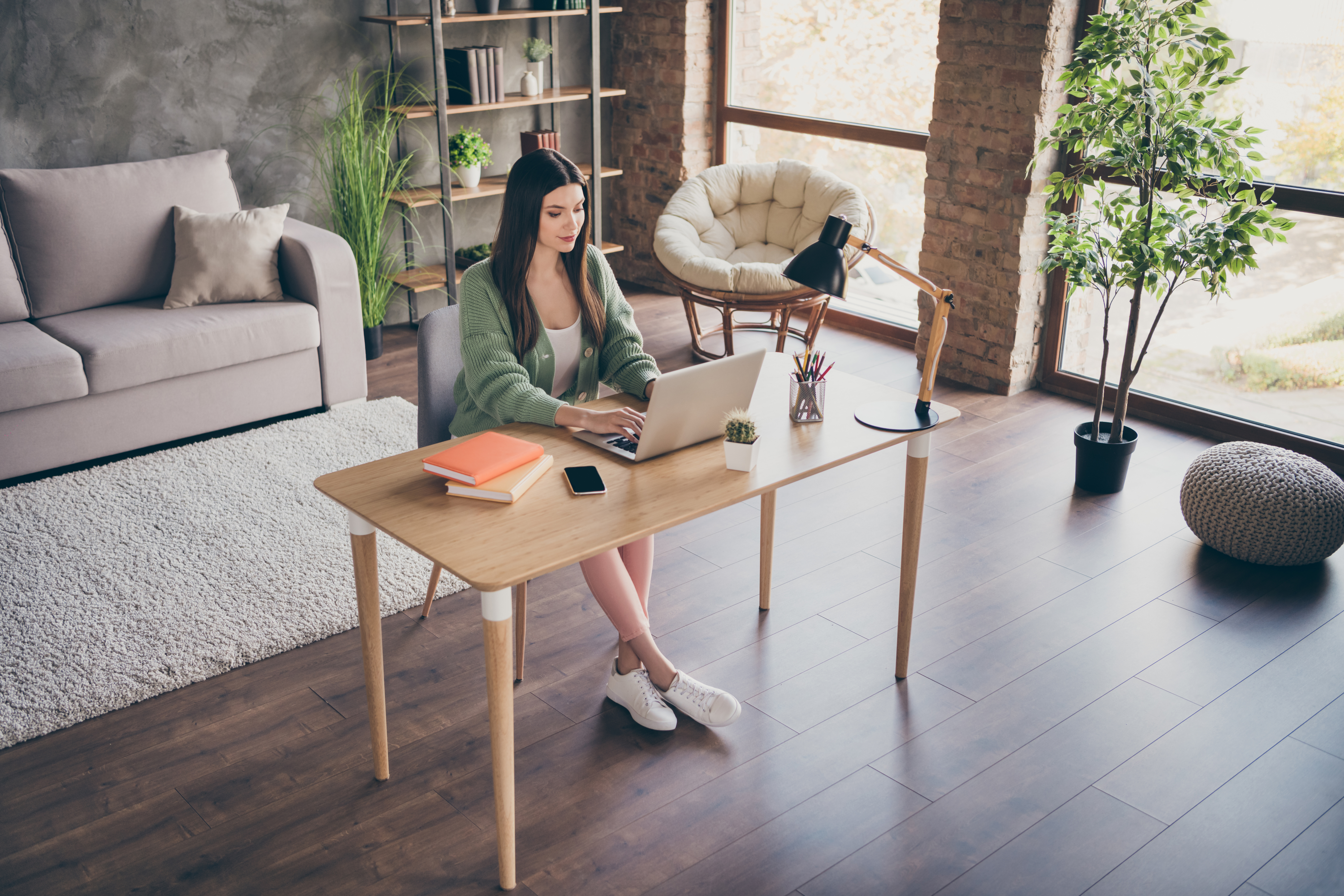 Photo of optimistic girl work laptop from home wear green shirt sneakers indoors